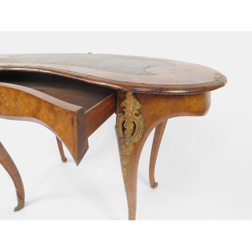 17 - A Victorian burr walnut and marquetry kidney shaped lady's writing table in the manner of Gillows, w...