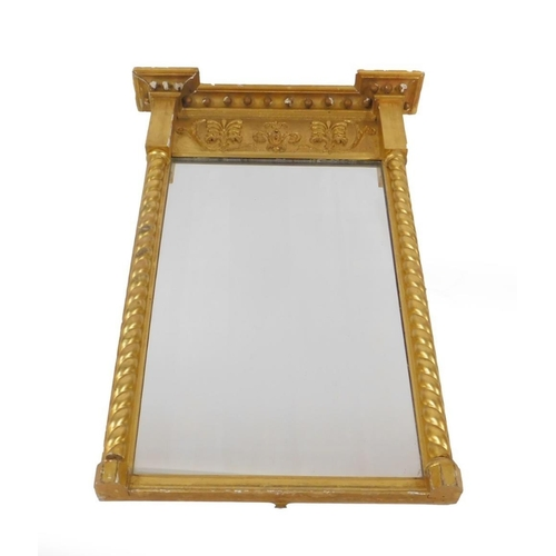 18 - A Regency gilt pier glass, of rectangular form with ball ornamentation to the top and a frieze of gi...