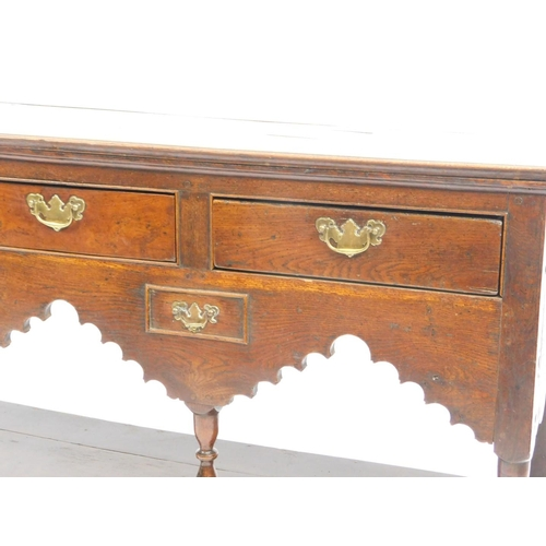 29 - An 18thC oak dresser base, the rectangular plank top raised above three frieze drawers and two furth...