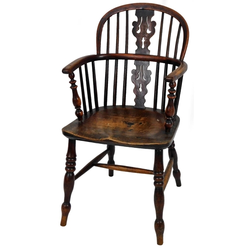 4 - An early 19thC yew wood low back Windsor chair, with pierced Christmas tree splat, turned legs and H...