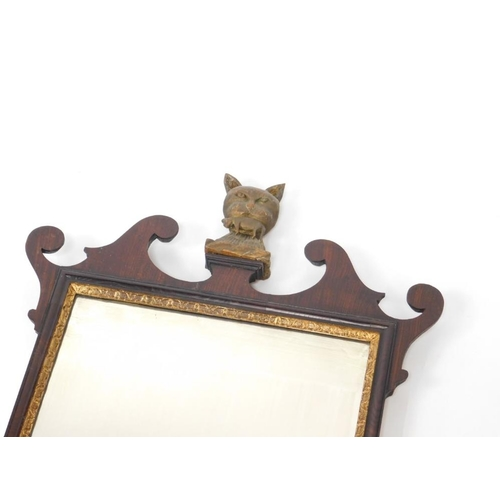 7 - A George III pier glass, possibly walnut, with fretwork frame, parcel gilt slip and pediment finial ...
