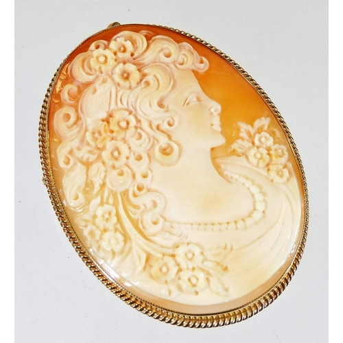 46 - A 9ct gold framed shell cameo brooch, with oval cameo of maiden looking left, with flowing hair with...