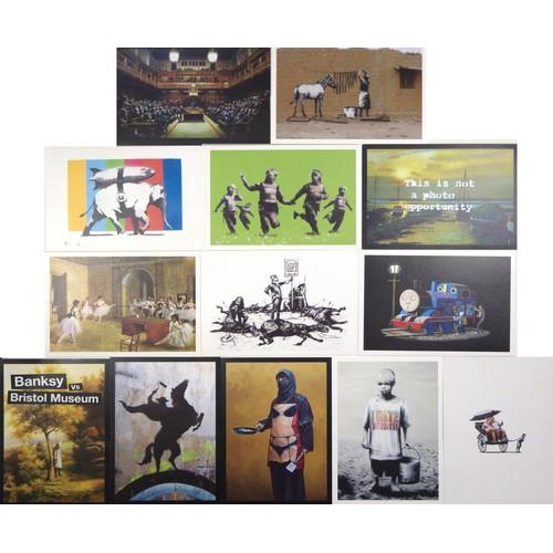 29 - Banksy. Postcards:  A complete set of 12, unused, Banksy vs Bristol Museum...