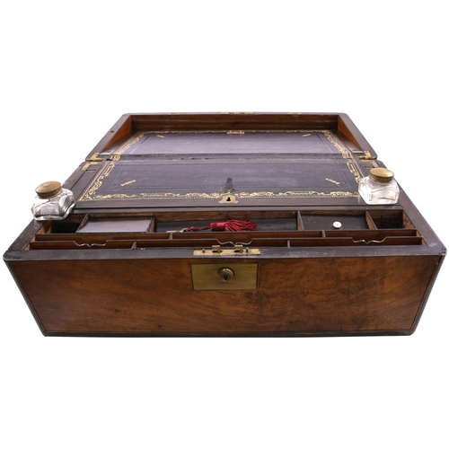 52 - A Victorian portable walnut writing box, circa 1870, a brass plate set into the top