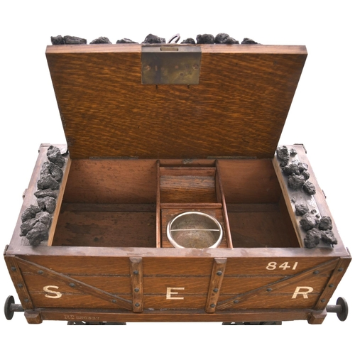 59 - A humidor (tobacco cabinet), in the form of a South Eastern Railway coal wagon. Overall length 13