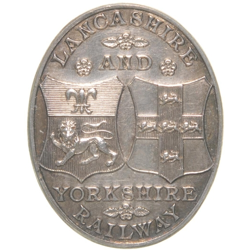 154 - A Lancashire and Yorkshire Railway free pass with the company coat of arms, the back with rose decor...