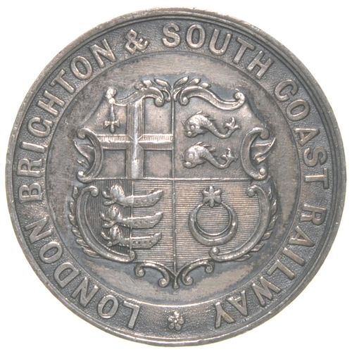 """A London, Brighton and South Coast Railway pass issued to Samuel Laing Esq M.P., Director. Silver, 1⅛"""" diameter, featuring the company coat of arms. (Postage Band: A)"""