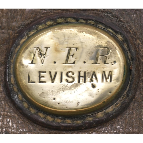 3 - A North Eastern Railway cash bag with a brass plate N.E.R. LEVISHAM, a station on the Whitby and Pic...