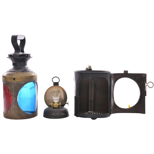 36 - A London and North Western Railway three aspect handlamp with brass collar, the body prominently sta...