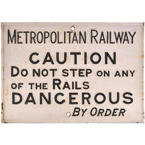 55 - A Metropolitan Railway warning notice, METROPOLITAN RAILWAY, CAUTION, DO NOT STEP ON ANY OF THE RAIL...