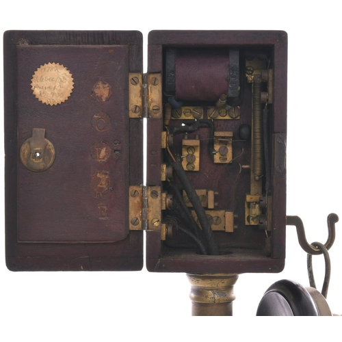 8 - A Midland Railway candlestick telephone, complete with brass stand and original combined ear and mou...