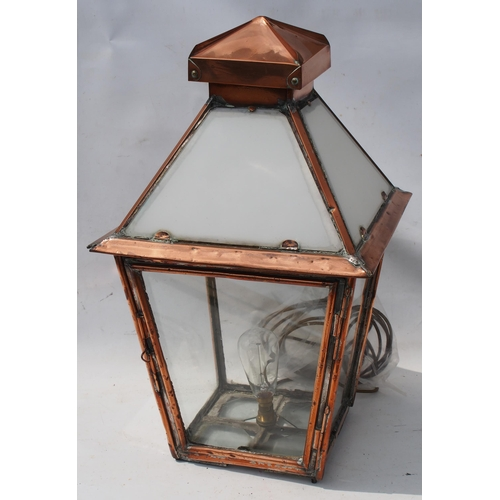 24 - Copper four sided platform lamp, milk glass roof panels, has electric light fitted (not tested), ver...
