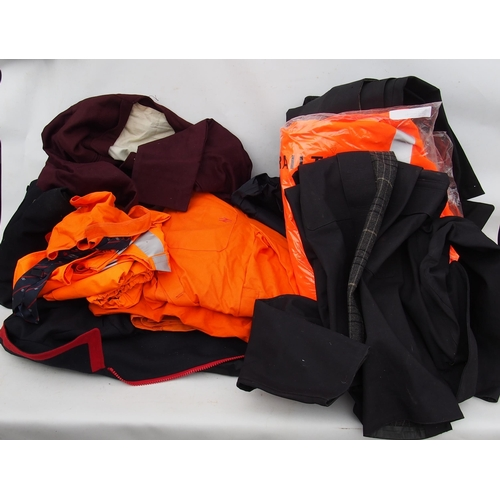 57 - Large quantity of railway uniform jackets, overcoats, trousers, PPE, some unused & still in wrapping...