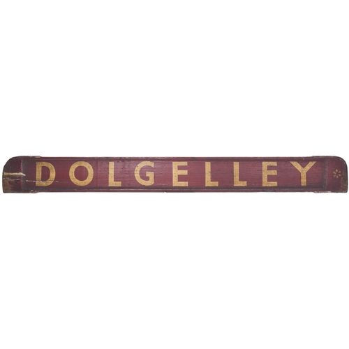 """A small carriage board, DOLGELLY-BARMOUTH, as used for local trains on the route from Ruabon. Painted wood, 32""""x3¼"""", original condition. (Postage Band: C)"""