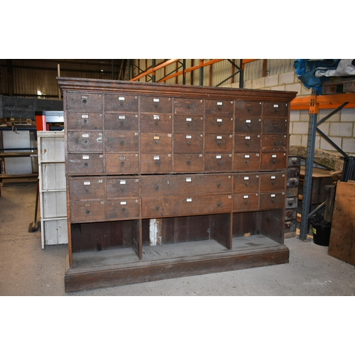 162 - An impressive 42 drawer oak shop fittings 93