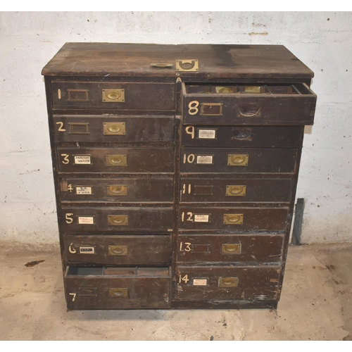 21 - A wood multi-drawer chest with 14 drawers                  Subject to VAT