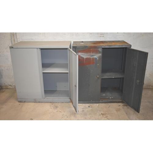 24 - Two double door steel cupboards with shelves                     Subject to VAT