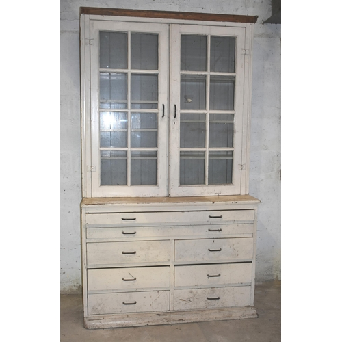 26 - A large pine glazed bookcase/plan chest                                                         Subj...