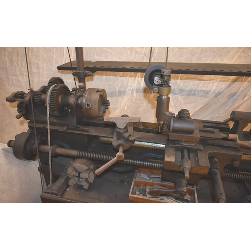 325 - A rare vintage Britannia lathe c/w overhead gear, milling spindle, change gear with cutters and acce...