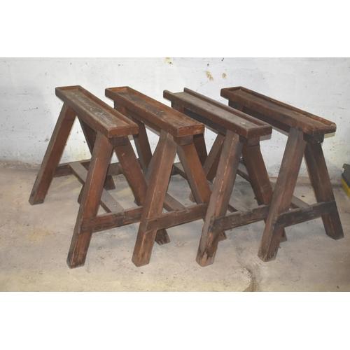 36 - Four upholsterer's wooden trestles c/w two tops                                                     ...