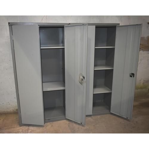 4 - Two double door steel cupboards with shelving                    Subject to VAT