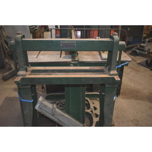 50 - A vintage printer's letterpress perforating machine and a punching machine                          ...