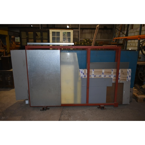 56 - A large sheet metal rack containing a quantity of galvanised and sheet steel                        ...