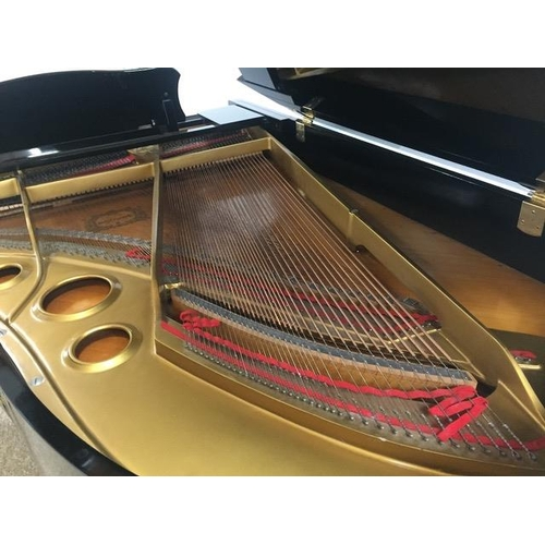 58 - Yamaha (c1972) A 6ft 7in Model G5 grand piano in a bright ebonised case on square tapered legs....
