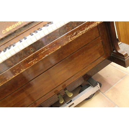 43 - Bechstein (c1879)  An upright piano in a figured walnut case....