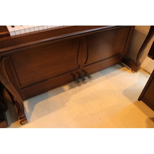 7 - Hoffmann (c1985)  A Model Barock/Chippendale upright piano in a mahogany case with cabriole supports...