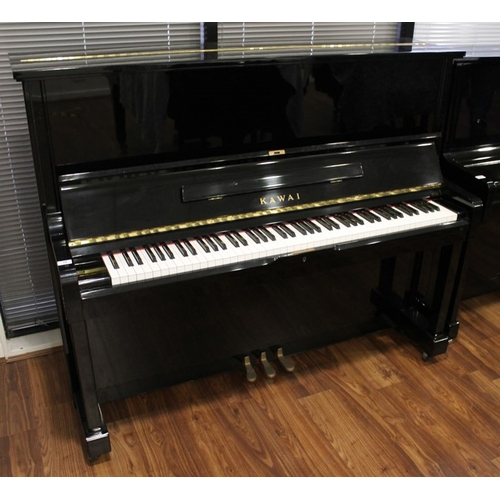 16 - Kawai (c1985)  An upright piano in a traditional bright ebonised case; together with two matching st...
