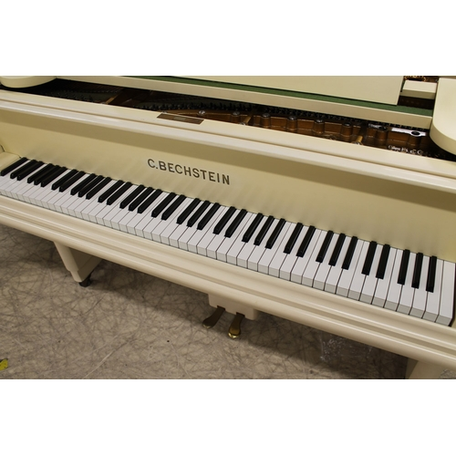 22 - Bechstein (c1924)  A 6ft Model A1 grand piano in a cream Art Deco case on slab legs.  This piano has...