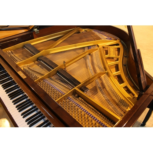 27 - Blüthner (c1984) A 5ft 1in Model 11 grand piano in a bright mahogany case on square tapered legs....