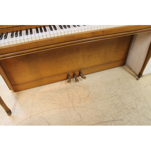 29 - Yamaha (c1971)  An upright piano in an American 'spinet' style case; together with a matching stool....