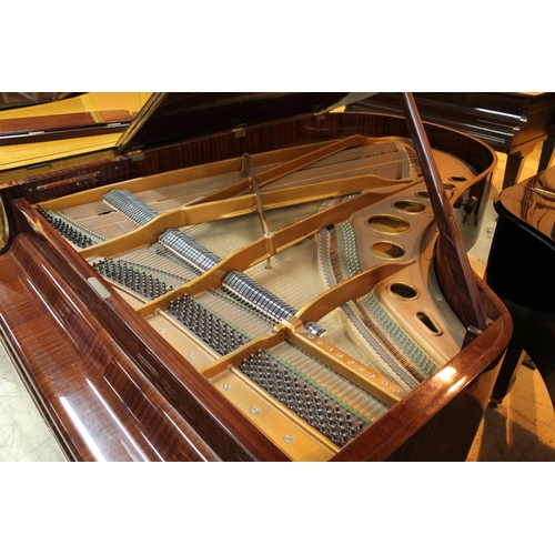42 - Bosendorfer (c1971)  A 6ft 7in grand piano in a bright mahogany case; together with a stool. AMENDME...