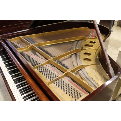 55 - Steinway (c1927) A 5ft 10in Model O grand piano in an ebonised case on square tapered legs; together...