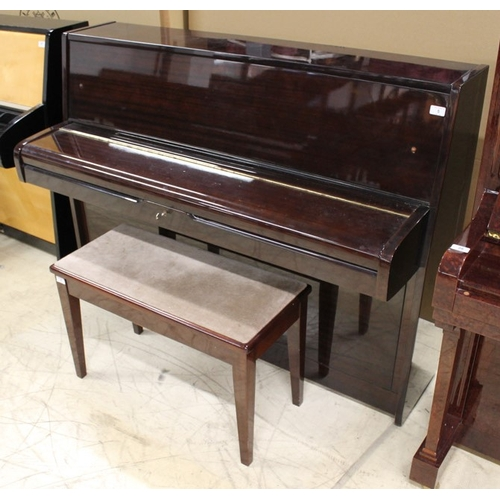 5 - Elysian A recent upright piano in a modern style bright mahogany case; together with a stool...