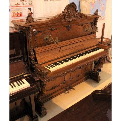 10 - Berdux (c1892)   No 4815 An upright piano in a carved mahogany Rococo case decorated with shell and ...