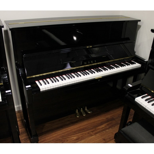 11 - Miki  A 121cm Model MU1D upright piano in a bright ebonised case....