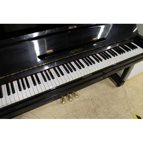 13 - Apollo (c1963)  An upright piano in a traditional bright ebonised case...