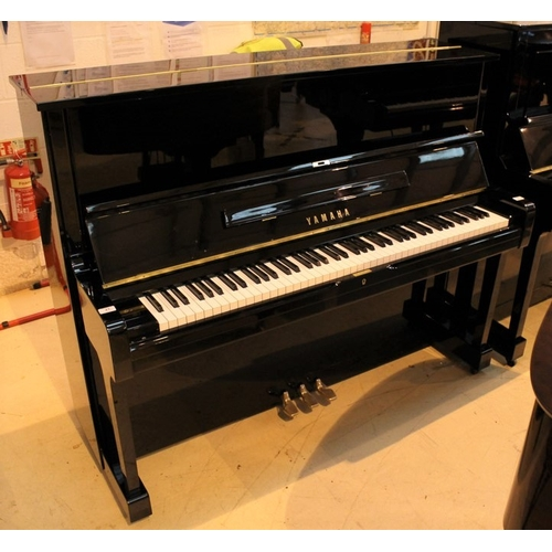 21 - Yamaha (c1977)  A Model U1H upright piano in a bright ebonised case....