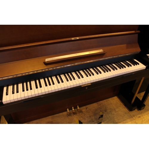 31 - Yamaha (c1958)  A Model U3B upright piano in a brown and black satin case....