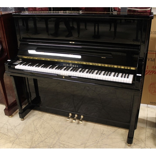 35 - Schimmel (c1995) A Model 130 upright piano in a bright ebonised case....