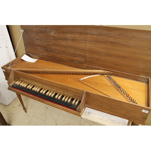 36 - Alec Hodsdon Virginal A virginal in a light wood case on turned fluted legs, the fascia bearing the ...