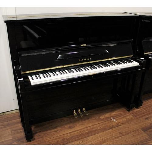 41 - Kawai (c1960)  A Model K-8 upright piano in a bright ebonised case....