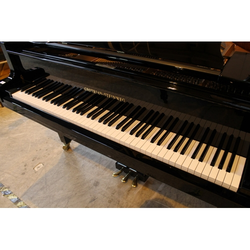 45 - Grotrian Steinweg (c2011) A 6ft 3in Model 192 grand piano in a bright ebonised case on square tapere...