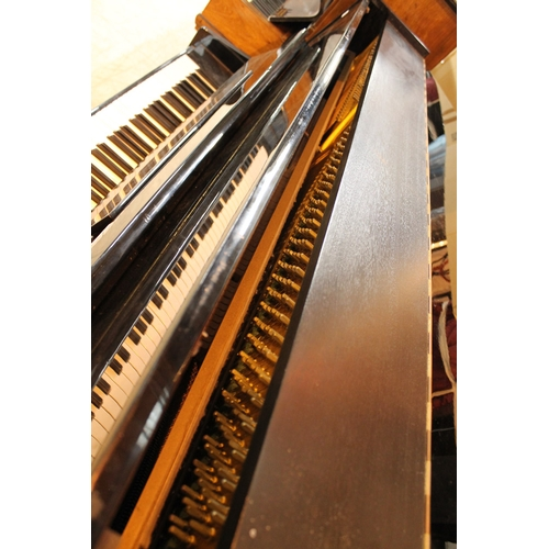 46 - Ronisch   A recent 113cm upright piano in a bright ebonised case....