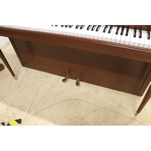 49 - Knight (c1972)  An upright piano in a colonial style mahogany case....