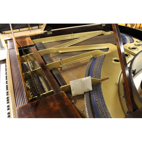 52 - Blüthner (c1906)  A 6ft 3in grand piano in a rosewood case on turned and fluted legs....