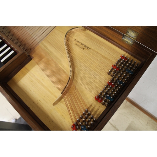 54 - Morley clavichord A Morley clavichord in a walnut case on turned and fluted legs....